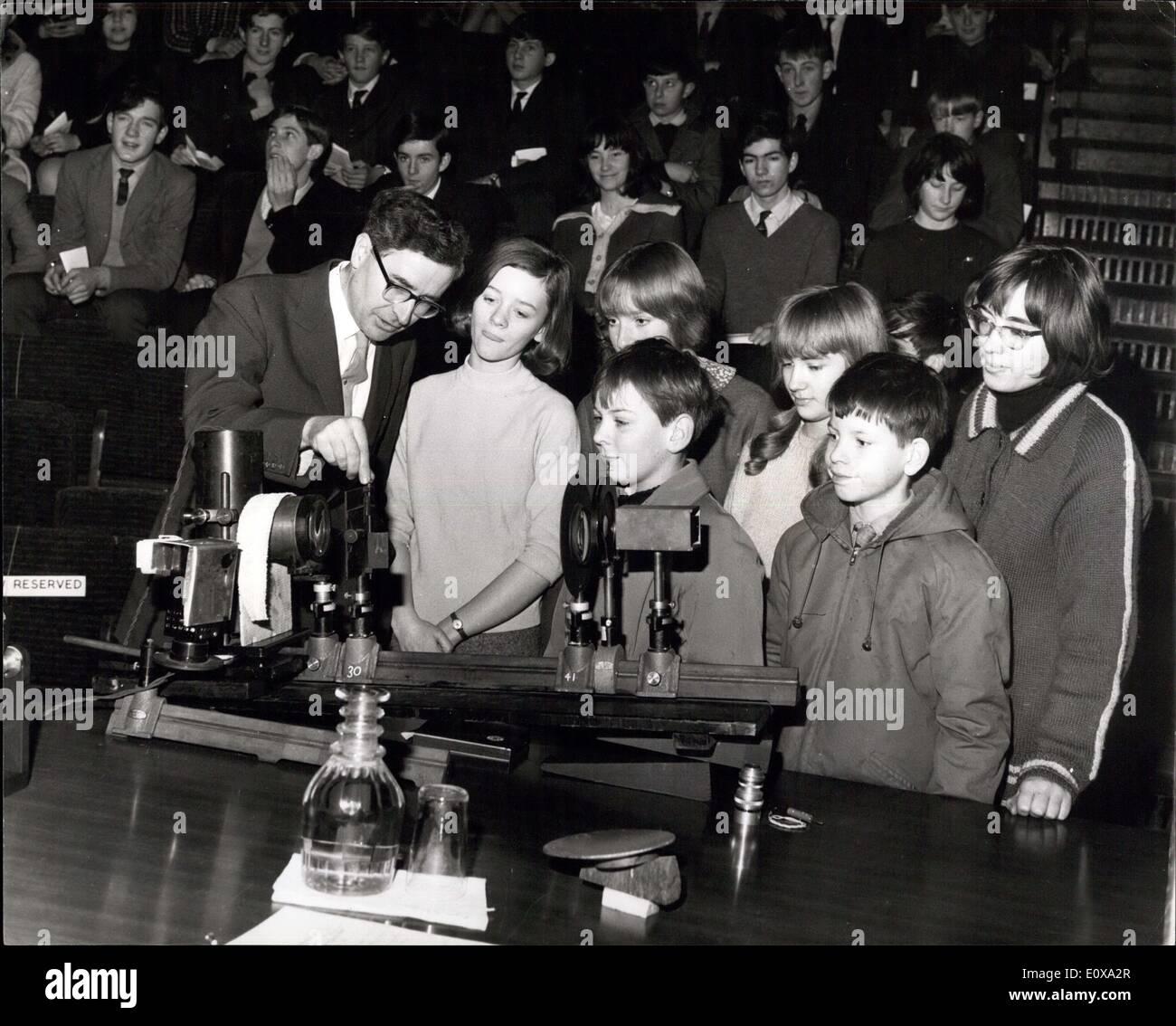 Dec. 28, 1965 - Christmas lectures at the Royal Institution: The first of a course of six lectures, the subject of which is ''The Exploration of the Universe' - by Sir Bernard Lovell, O.B.E., F.R.S., and Professor F. Graham Smith, M.A., of the Nuffield Radio Astronomy laboratories, Jodrell Bank and by Professor Martin Ryle, M.A., F.R.S. and Dr. A. Hewish, of the Mullard Radio Astronomy observatory. Cambridge, was held today at the Royal institution, Albemarle-Street. Photo Shows Dr. A - Stock Image