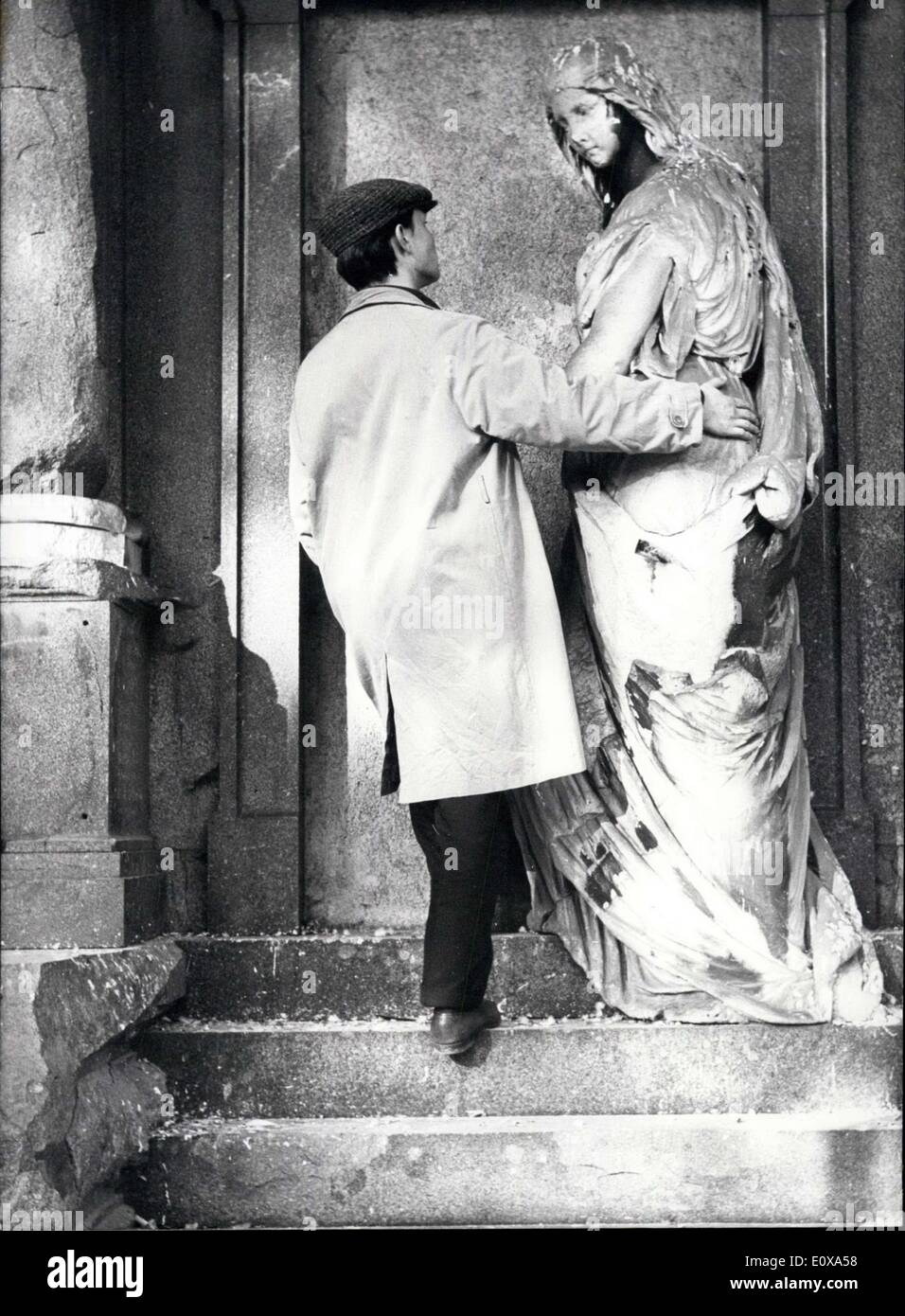 Oct. 27, 1965 - Take Care of his ''Figure''... must this young man, otherwise he could get lost of it. Our photographer saw this ''dissimilar couple'' at Munich's oldest church-yard. - Stock Image