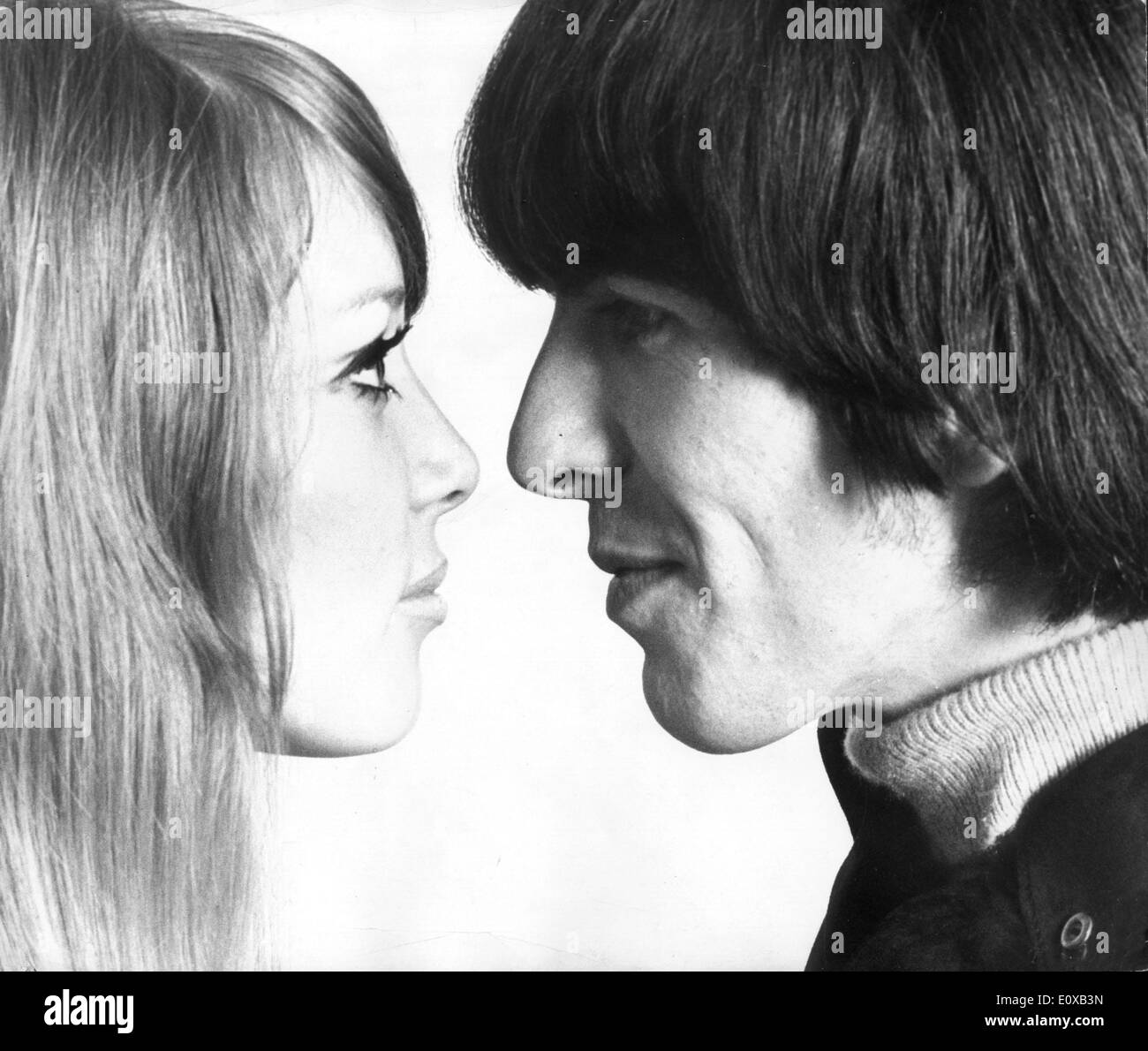 Portrait of George Harrison and wife Pattie Boyd looking at each other - Stock Image