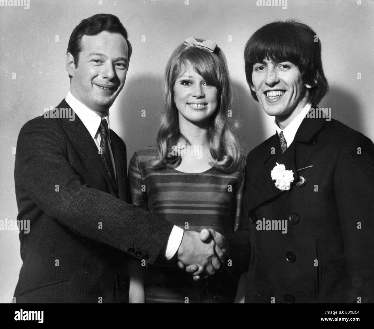 Brian Epstein congratulate George Harrison and wife - Stock Image