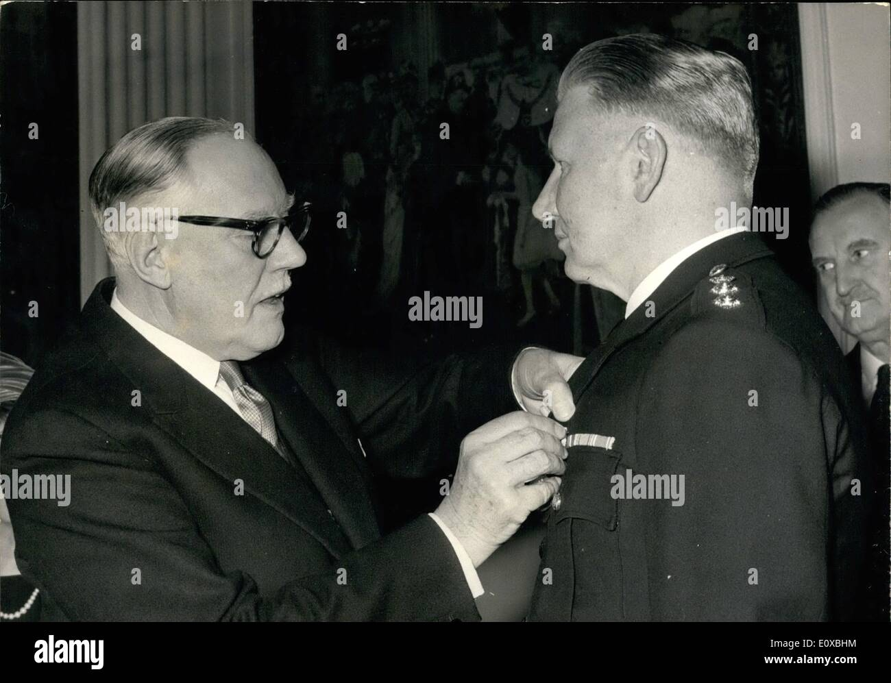 Mar. 03, 1966 - Lord Mayor presents queens Police Medal. The Lord Mayor of London, Sir Lionel Denny , this afternoon presented the Queen's Police Medal to Chief Superintendent Bertram Flatt, at the Mansion House. Photo shows The Lord Mayor of London pins the Queen's Police Medal on Chief Supt. Bertram Flatt at the Mansion House this afternoon. - Stock Image
