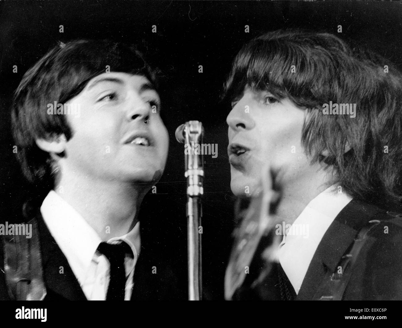 The Beatles Paul McCartney and George Harrison at a concert at Shea Stadium - Stock Image