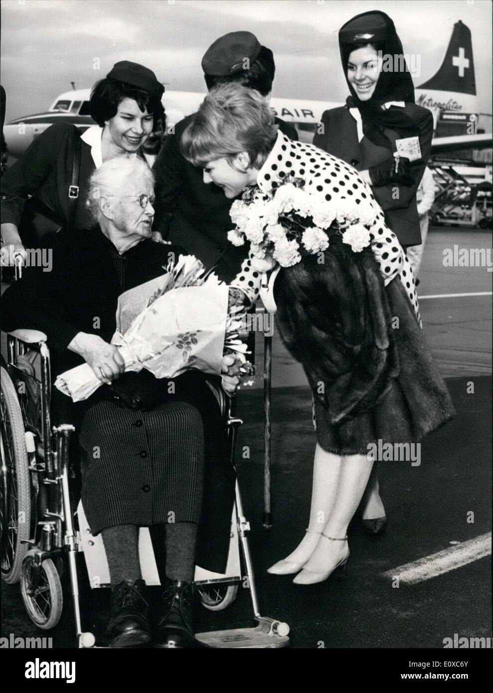Feb. 10, 1966 - Sophie Widmer of Lenzbourg just celebrated her 103 birthday. She ended up meeting Petula Clark on a Swissair flight from Zurich to Geneva. Clark made sure to congratulate Widmer. - Stock Image