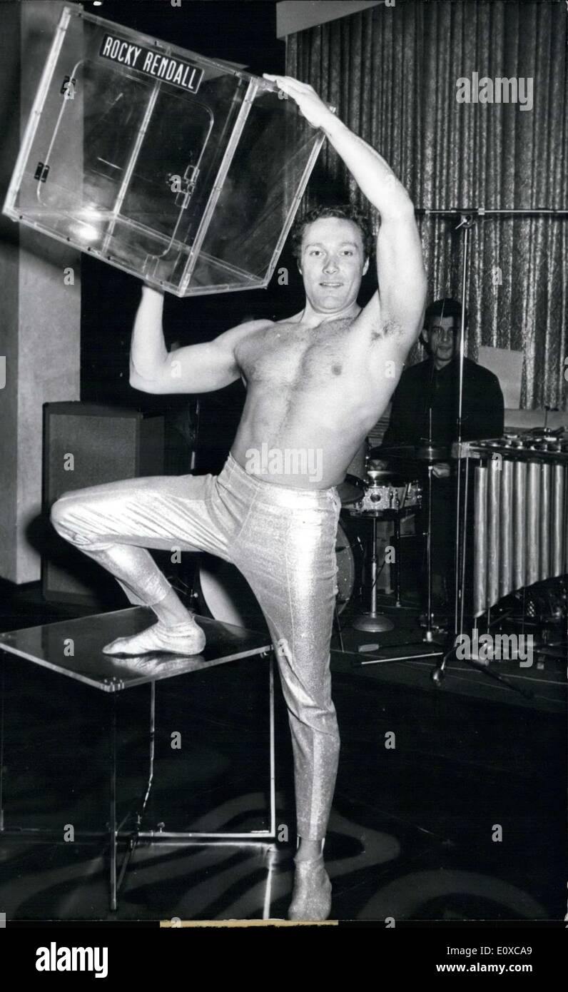 Mar. 29, 1966 - 78 kilogram man sitting in a 49 cm high box: Some years ago it began with an old ice box. A young boy, called Rocky Redall, tried to take place in this old kitchen requisit. Seven years later he has succeeded: Rocky Redall was the world champion of body compression. Presently the born Swiss is to admire at the Ertotica Bar in Nuremberg where he shows his feat for a fee of some thousands of DM. The artiste who is 1,73 m tall and weighs 78 kf takes place in a box made of plexi-glass which is only 49 cm high, 49 cm broad and 49 cm long - Stock Image