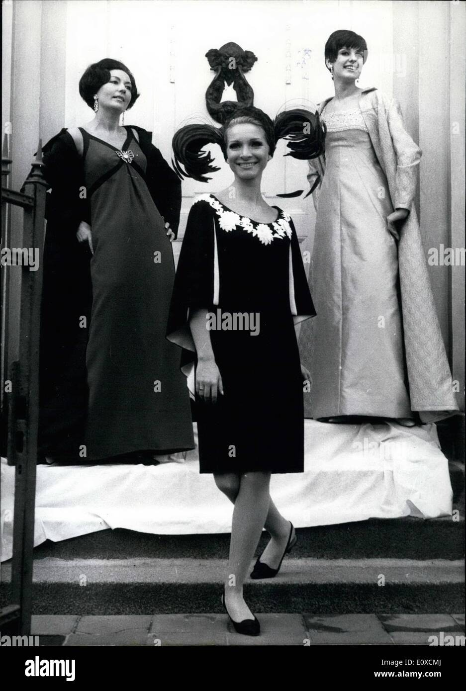 Apr. 04, 1966 - 64th International Berliner Durchreise. In connection with the ''64th International Berliner Durchreise'', an influential fashion show which takes place of April 13th till Aptil 22nd, the Berlin fashion designer Heinz Ostergaard presented his new collection for the autumn winter season 1966-1967. OPS: An evening dress made of turquoise colored, Romain in empire style with embroidery, left, and an evening dress made of silken Alabaster colored Shantung with a cloak of French lace, right. A cocktail hat made of hen feathers and black dress which is decorated with St - Stock Image