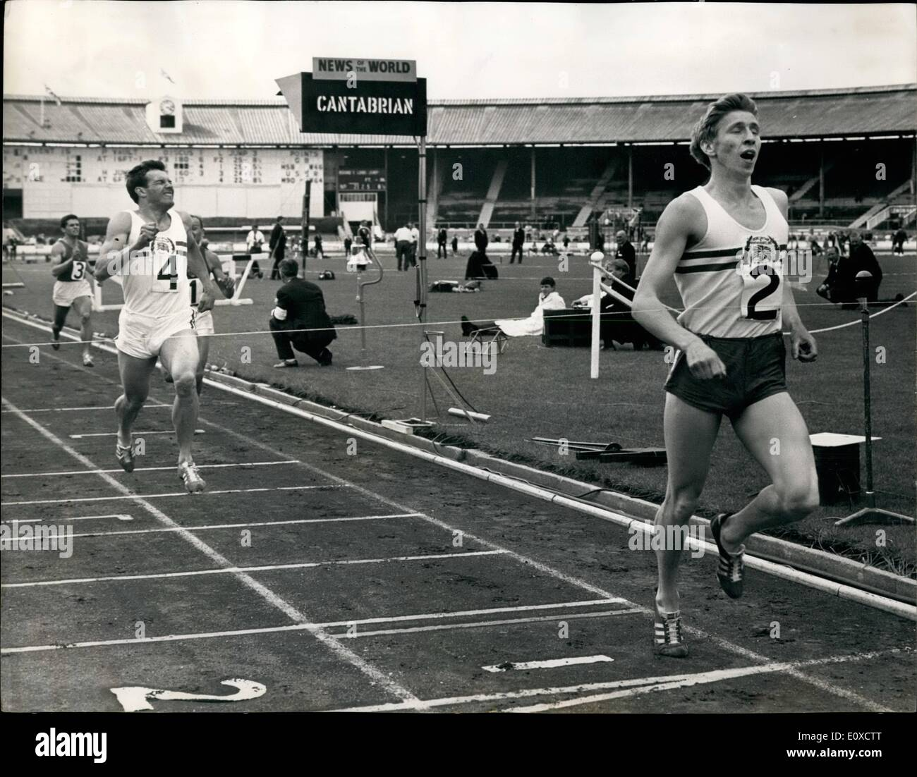 Jun. 06, 1966 - Boulter Wins 800-Meters For Britain: London: John P.Boulter (Achilles Club) of Britain is pictured winning the 800-Meters (Men) (87408 yards) event from Christopher S. Carter (Brighton and have Athletic club) Britain (No:4) second; Russia's Vadim Mikhay;lov (No:1) Third and Russia's Remir Mitrofanov (No:3), during the second and Final day of the Britain and Northern Ireland Versus Russia International Athletics Match organised by the British Amateur Athletic Board at the White City Stadium Today, June 18 - Stock Image