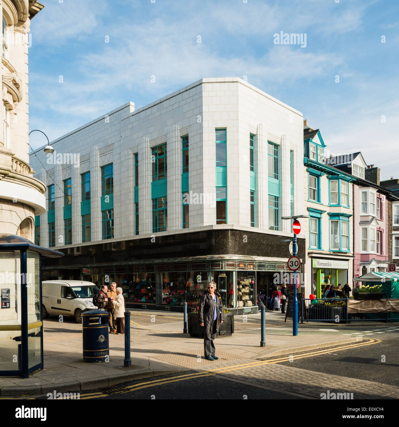 The newly renovated white marble clad Art Deco style former Burton's store in the centre of Aberystwyth Wales UK - Stock Image