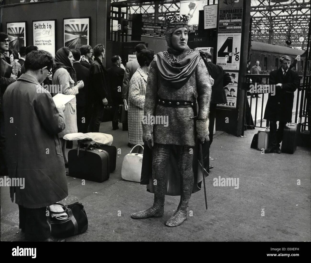 Jul. 07, 1966 - A KNIGHT ON CHARING CROSS STATION. Some 900 years ago William the Conqueror landed at Hastings in the year 1066. This year Hastings are holding a requiem off the 1066 defeat. So 25 year old NORMAN McGOWAN, in full Norman gear, took the easy way to get to Hastings by train from Charing Cross and not like William the Conquerer who arrived by beat. PHOTO SHOWS: NORMAN McGOWAN, seen waiting for the Hastings train at Charing X station last night. - Stock Image