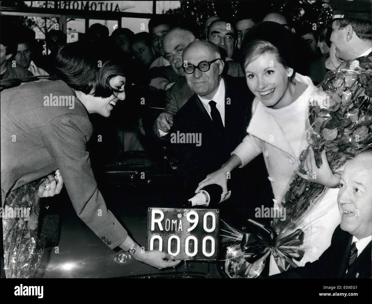 Jul. 07, 1966 - The number plate Roma 900.000 has been assigned at a car ''Innocenti Mini Minor 850'' bye the beautiful blonde TV speaker Gabriella Farinon, today at the Automobile Club headquarter. The kind of plate is in Italy progressively. The number plate no. 1 was assigned in Rome on 1927. Just be precised that every Italian, province has the progressive numeration and the first city that has reached the n. 1.000.000. was Milan, Northern Italy. OPS = TV speaker Gabriella Farinon ''wished'' with a bottle of champagne, the new number plate Roma 900.000. - Stock Image