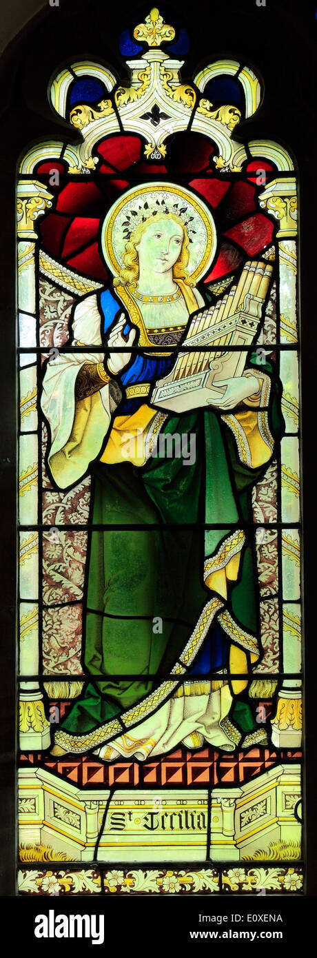 St. Cecilia, stained glass window, playing a viola, small organ, c.1890, by Heaton, Butler & Bayne, West Newton, Norfolk England - Stock Image