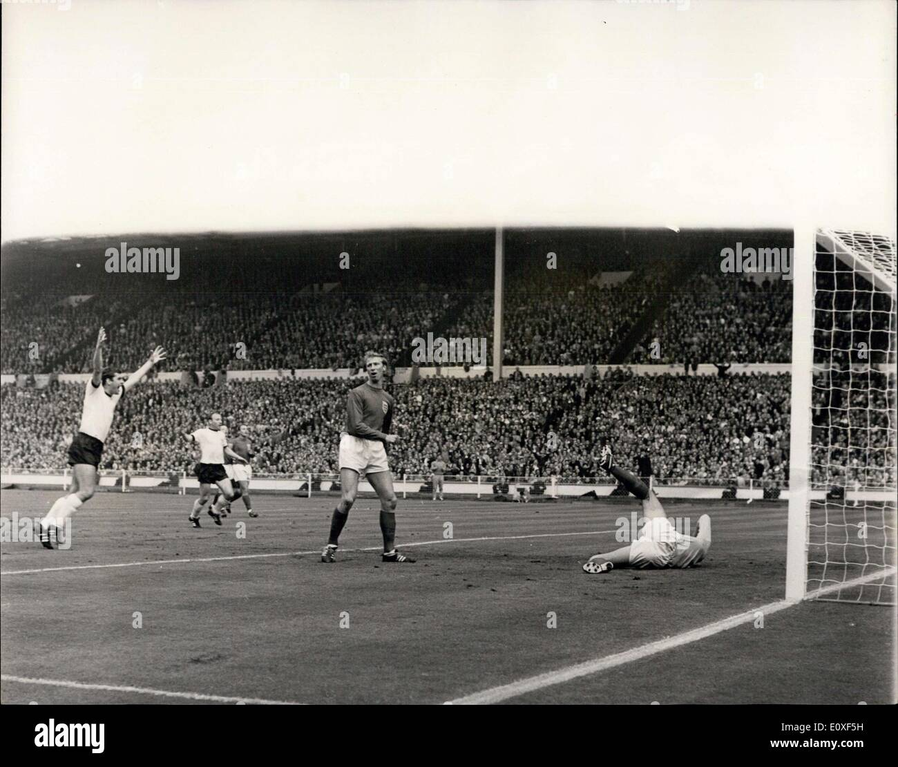 Jul. 30, 1966 - World Cup Football ? England v. West Germany World Cup Final at Wembley. Photo Shows: Haller of West Germany beats England goalkeeper Gordon Banks to score Germany?s first goal. - Stock Image