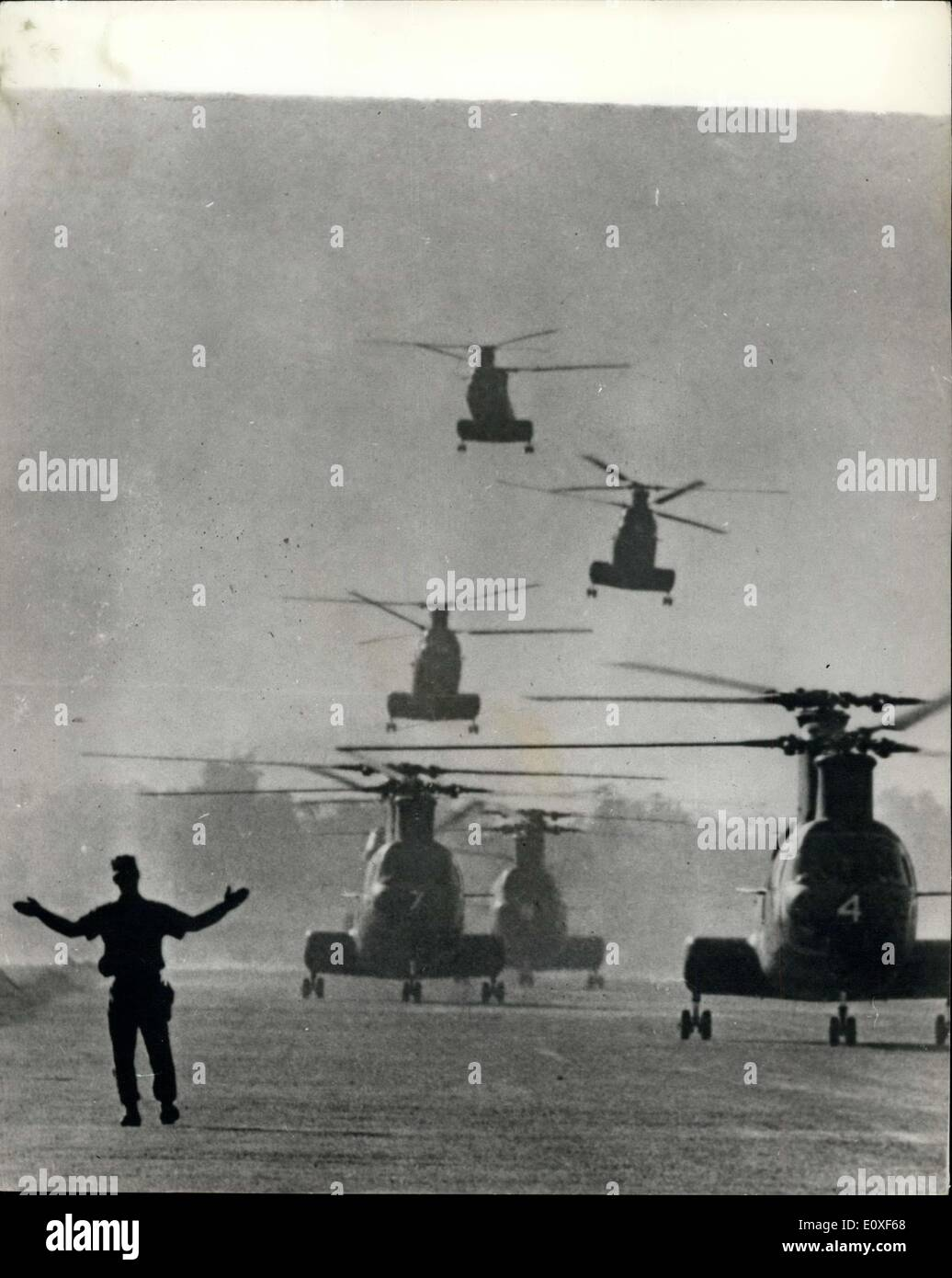 Aug. 04, 1966 - The war in Vietnam: A member of the ground crew of Marine Helicopter Squadron helps to guide a flight of Sea Knight helicopters in for a landing after an operation near Chu Lai, Vietnam. - Stock Image
