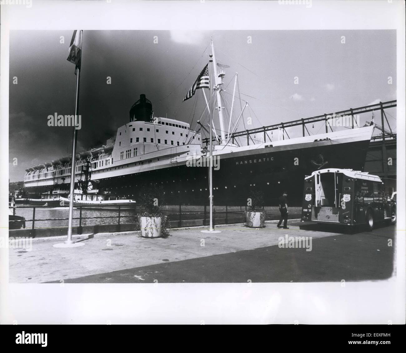 Sep. 09, 1966 - 30,000 ton German liner Hanseatic in five alarm fire at New York Hudson River Pier: Leaking diesel fuel caused fire injuring 7 firemen and causing great damage to vessel owned by Atlantik Line & Co. of Hamburg. It took 300 firemen and 50 apparatus to get control after 7 hours. Three city fire boats, several police helicopters and two Coast Guard vessels came to help but were not used. All the action was below deck. Foam was used extensively rather than water to avoid capsizing of the boat. There were only few passengers on board, were quickly evacuated, none injured - Stock Image
