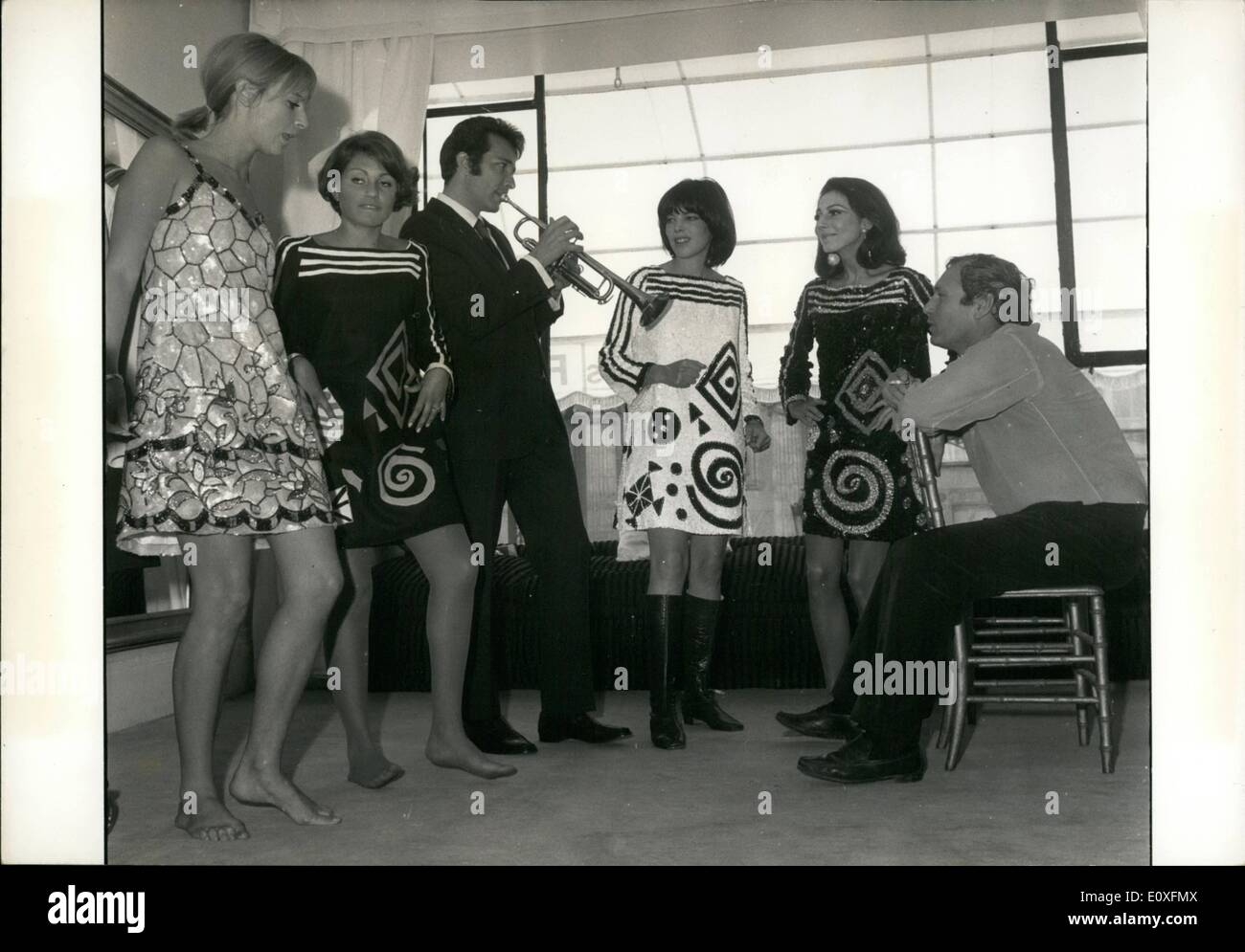 Sep. 09, 1966 - Famous Trumpet player serenades Feraud;s mannequins: Herb Alper, The famous AMerican Trumpet Player, is now in Paris. Today he paid a visit to the Paris Couturier Lous Feraud, Photo shows Alpert pictured serenading Feraud's models Feraud is seen on the right. - Stock Image