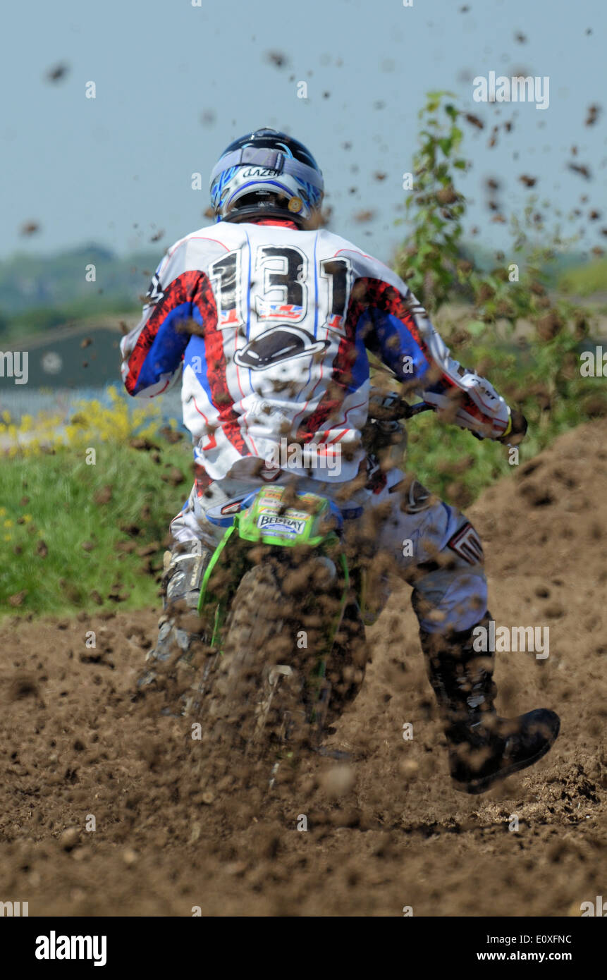 Motocross is a form of motorcycle racing held on enclosed off-road circuits. The sport evolved from motorcycle trials comps - Stock Image