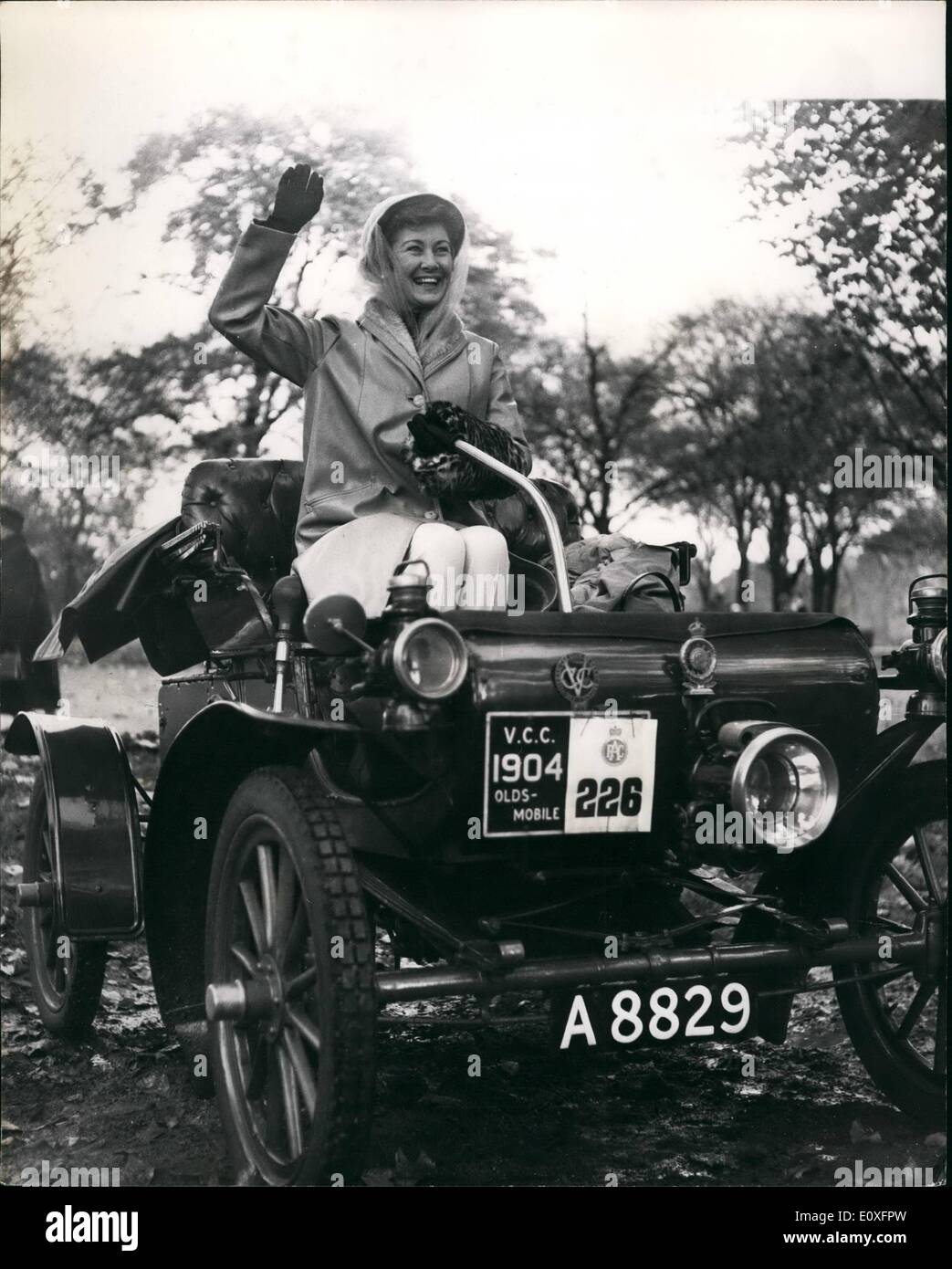 Nov. 11, 1966 - The R.A.C.'s Veteran Car Run From London To Brighton: There was a full entry of 250 cars - and 16 reserves - for this year's Royal Automobile Club Veteran car run from London to Brighton. Of the 250 cars taking part in the 53-mile journey, which started from Hyde P[ark, 27 were pre-1900. Photo Shows Film actress Dinah Sheridan who starred in the film ''Genevieve'' took part in the run for the first time when she trevelled in a 1904 Oldsmobile, entered by Mr. G.E. Mawer, President of the Veteran Cap Club. - Stock Image
