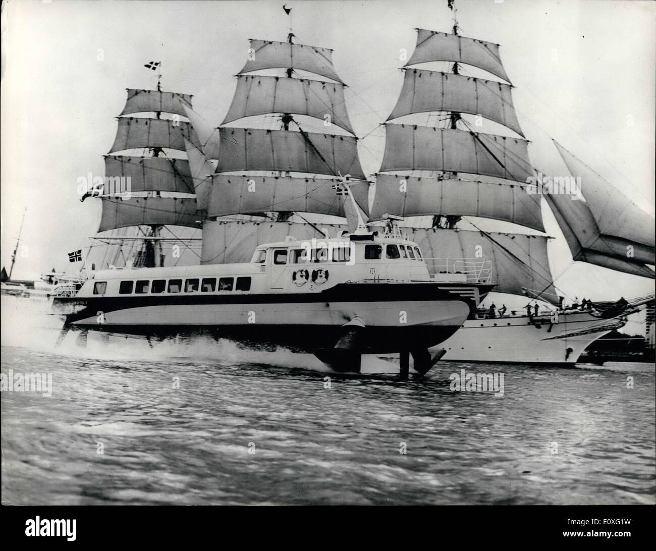Sep. 09, 1966 - Ancient and modern in the Shipping Yard. Photo Shows: This unique picture just received from Copenhagen shows the 1350 HK hydrofoil craft Sundfoil 1 at speed as it passes the Danish sailing Training ship Danmark with 80 cadets on board in Danish waters, each represents its own charm and individuality. - Stock Image