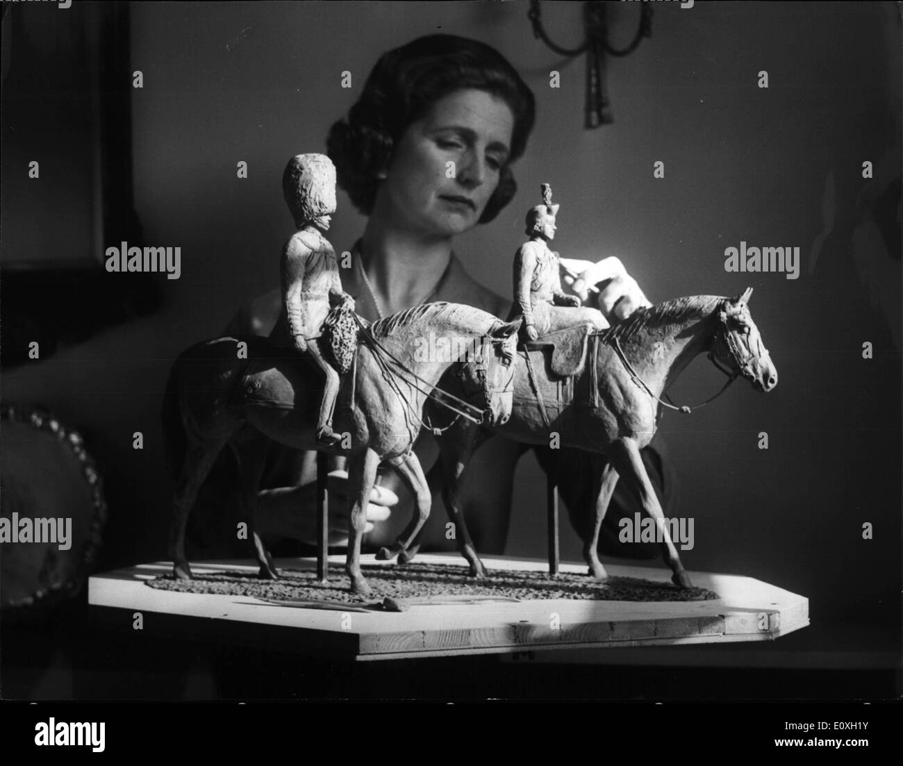 Oct. 10, 1966 - Statuette of the Queen and Duke. For the past few weeks, Sculptress Jean Walwyn has been in the Royal Mews taking a close look at the chestnut gelding Imperial and his stable companion, Linnhe. She has been commissioned by the United Service Club to create a statuette of the Queen and Prince Philip at last year's Trooping the Colour ceremony. It was the club's 150th, anniversary. Miss Walwyn, cousin of racehorse trainer, Fulke Walwyn, has almost finished the Plasticine models. They will then be cast in bronze and sprayed with gold - Stock Image