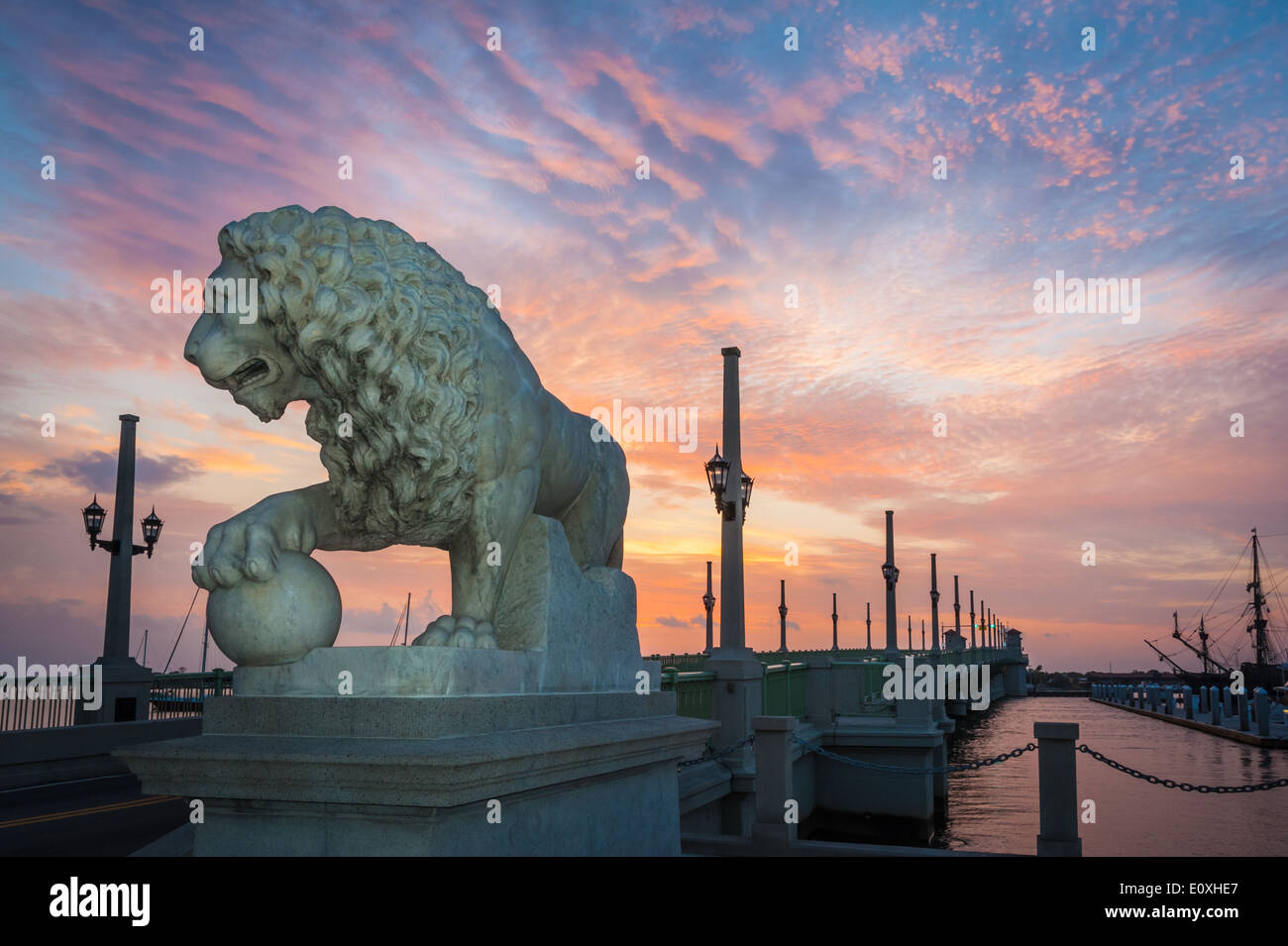 Sunrise paints the sky with color above the Bridge of Lions, a Florida landmark connecting St. Augustine to Anastasia Stock Photo