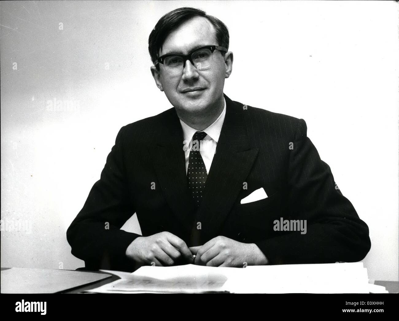 Jan. 01, 1967 - New Editor Of The Times; Mr. William Rees-Mogg, 38 year old deputy editor of the Sunday Times, was yesterday appointed editor of The Times. The new appointment was announced yesterday by Times Newspapers Ltd., who now own The Times and The Sunday Times. Photo shows Mr. William Rees-Mogg pictured today in the editor's office at The Times today. - Stock Image