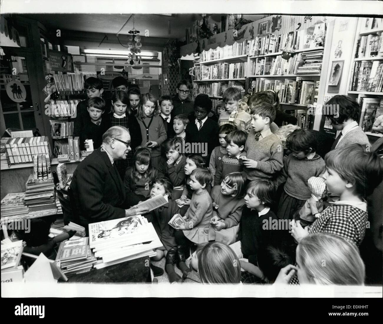 Jan. 01, 1967 - The bookshop where authors are people who read to you: Famous authors come from all over England to Joan Dashwood's Rainbow Bookshop in the Surrey country town of Walton-on-Thames. Very Friday, to a young audience they read aloud their new tales, old much-loves tales - and, it has been known to happen,even not-yet published tales. Yesterday about 40 children aged three to thirteen, gathered around the benevolent personage of Malcolm Saville, the author , as he read them a story - Stock Image