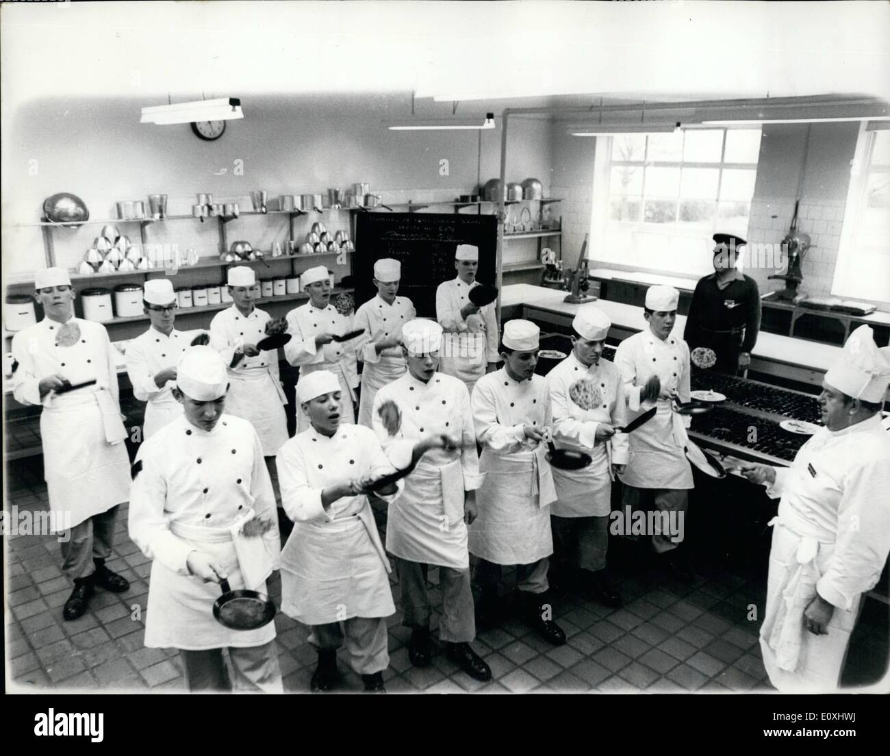 Jan. 01, 1967 - Learning how to toss a ;pancake the army way. There may be rather more than two weeks to go to shrove Tuesday, but when the day dawns the army catering corps are not going to be caught with their pancakers done, accordingly 50 apprentice cooks were deployed at corps he in aldershot for what the blackboard revealed to be ''Manual of army catering services recipe no. 559. Pancakes, 50. '' in command of the exercise was former warrant officer William janner, berm - and the bit where the pacakes were tossed turned out to be an only slightly flawed mast piece of military precision - Stock Image