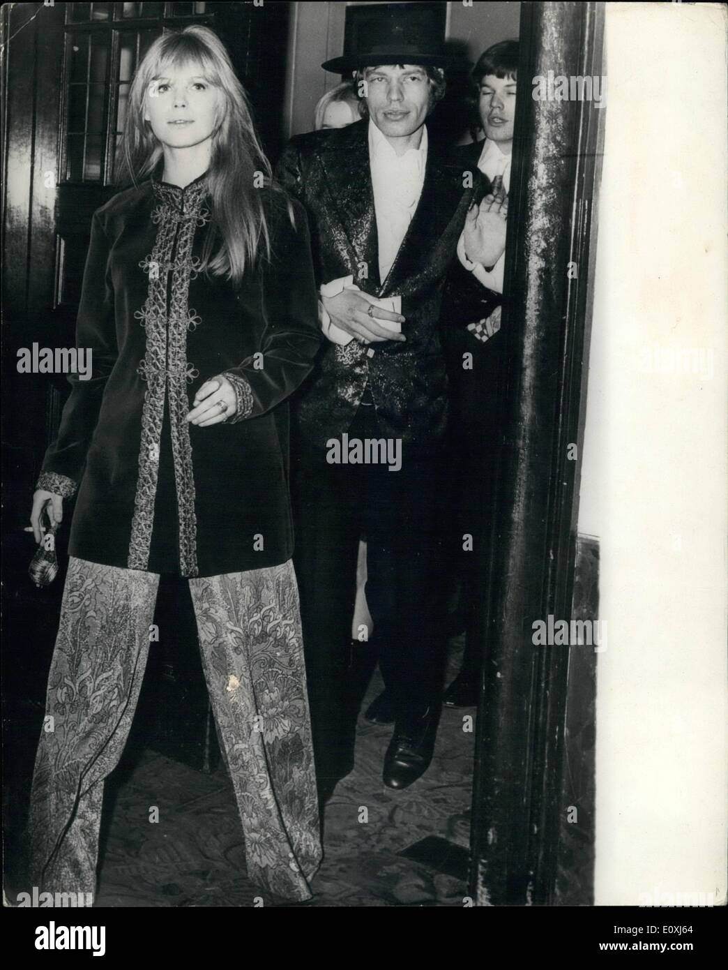 Feb. 02, 1967 - Gala Styles for Mick and Marianne: Setting their own styles for a night out at the ballet are pop star Mick Jagger, of the Rolling Stones and his friend, pop singer Marianne Faithful, pictured as they arrived at the Royal Opera House, Covent Garden, London last night, for the Royal Ballet gala performance. Mick is in a black sombrero and a jacket covered with multi-coloured embroidery. Marianne wears a braided velvet tunic with wide floral pants. The couple arrived just as the performance of was starting and they were hustled to their seats - Stock Image