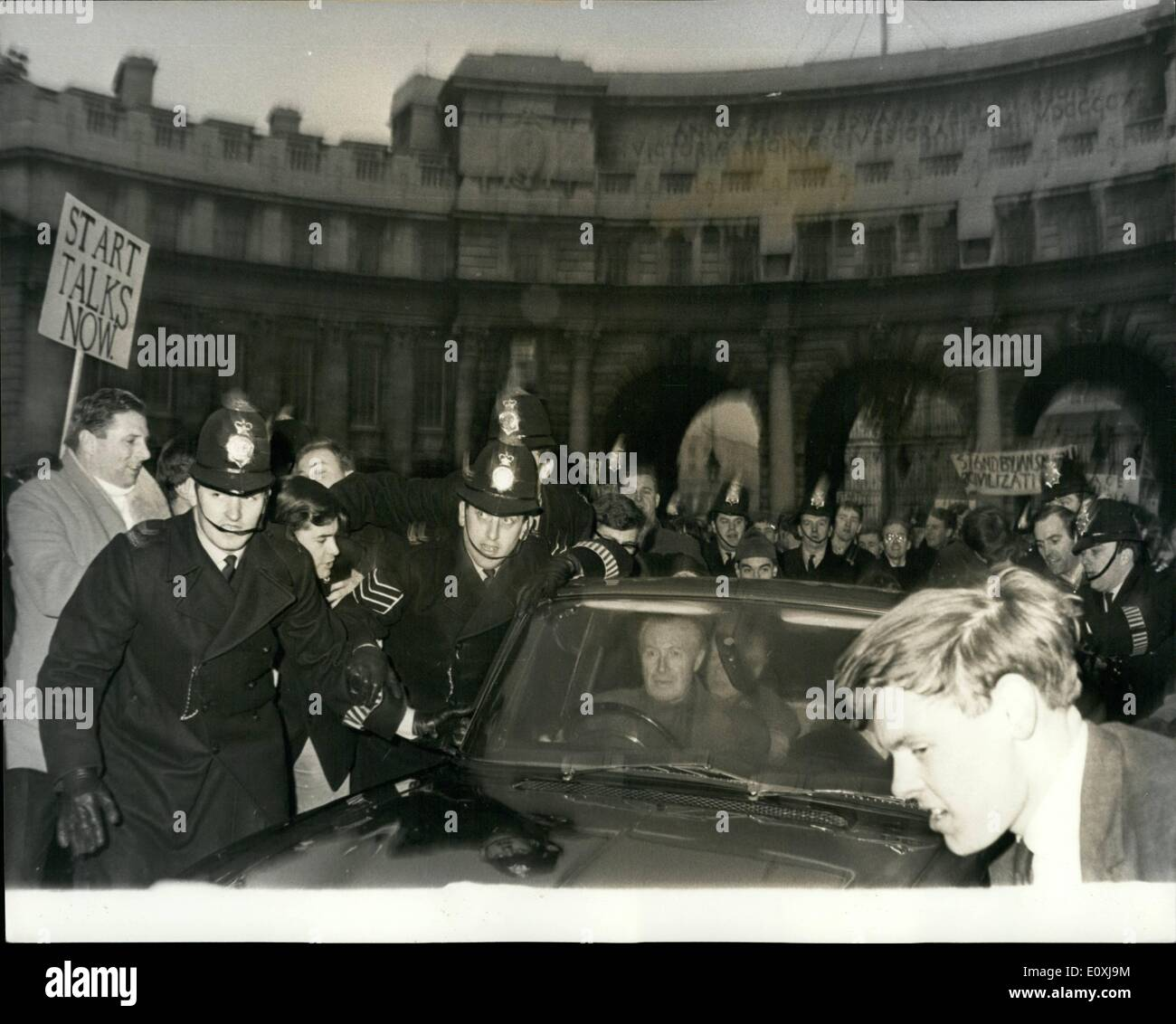 Jan. 16, 1967 - 16-1-67 Duncan Sandys holds a Peace-in-Rhodesia rally. Mr. Duncan Sandys, Tory M.P. yesterday held a Peace With Rhodesia rally in Trafalgar Square. After the rally, he was surrounded by a jeering crowd as he tried to reach his car. Some young demonstrators jumped on the car and others tried to overturn it. It was twenty minutes before Mr. Sandys and other Conservative MP's who had spoken at the rally were able to get clear of the crowd. Young Conservatives, Young Liberals and extremist groups from Right and Left were involved in scuffles during the rally and afterwards - Stock Image