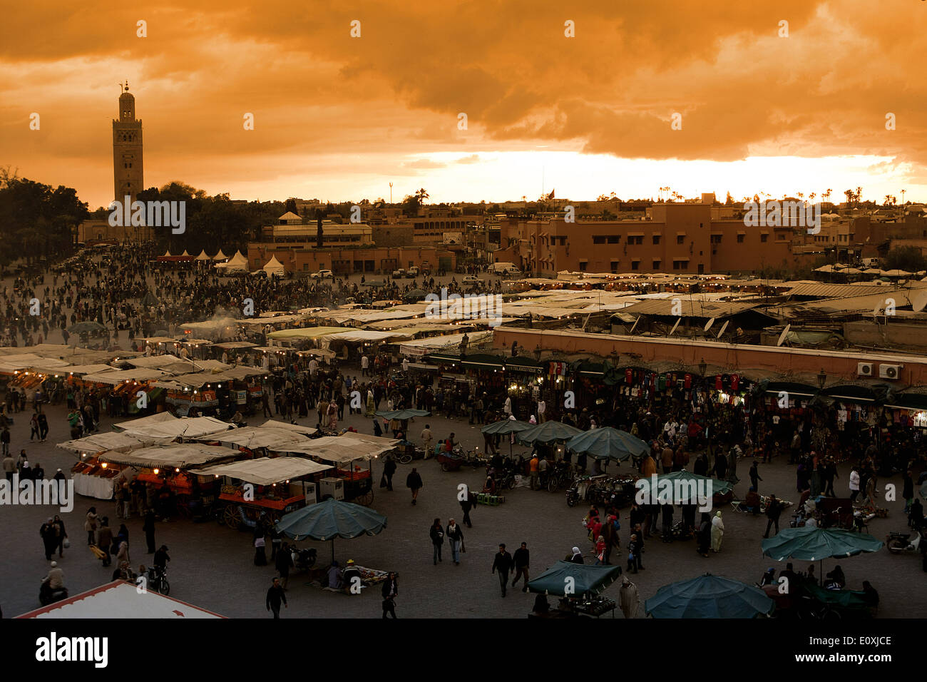 Jamaa el Fna,the main square in Marrakesh,Morocco.On background the Koutoubia mosque - Stock Image