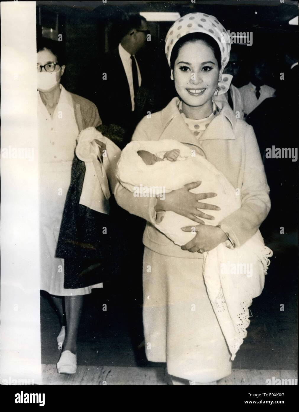 Mar. 03, 1967 - Sukarno's wife and baby leave hospital as he divorces one wife and marries schoolgirl: Ratna Sari Dewi, the Japanese wife of ousted President Sukarno, is shown leaving Koio University Hospital, Tokyo with her baby daughter Karita Sari meaning (essence of the stars). Meanwhile, the ex President has divorced his pretty 27 year old Japanes fourth wife, Mme Hajati Sukarno, whom he married on May 21, 1963, and is reported to have married a high school girl named Yurike Sanger. - Stock Image