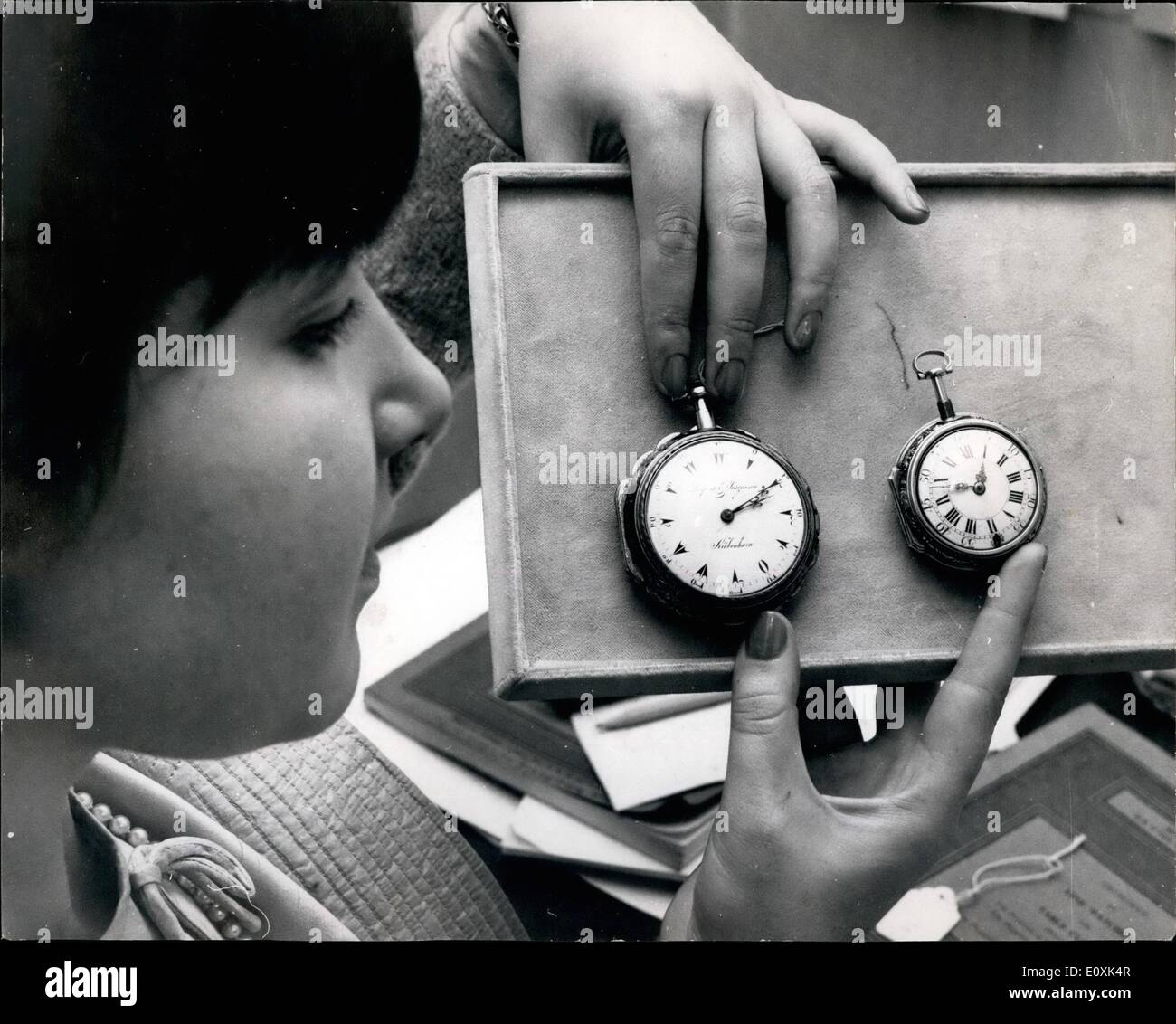 May 05, 1967 - TO BE SOLD BY AUCTION.: PHOTO SHOWS:- Two of the items which will be included in the sale of fine watches and table clocks which takes place at Sotheby's on May 22nd (ON LEFT). A rare Danish clock watch for the Turkish market by Larpent Jurgensen of Copenhagen, with verge movement, the white enamel dial with Turkish numerals, the gold inner case finely pieced and engraved with tortoiseshell and with scalloped edge, 62mm. diam. (Isaac Larpent and Jeorgen Jurgensan started a watch factory at Roskilde in 1780, which produced about 1500 watches - Stock Image