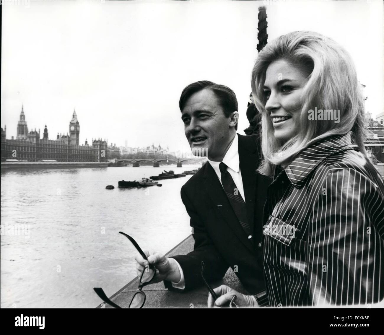 May 05, 1967 - The Man From U.N.C.L.E Is Guide. Robert Vaughn, the man from U.N.C.L.E - was being guide in London to a beautiful young American girl from Los Angeles called Karen Carlson, who won a London holiday with him as a TV competition prize. Photo Shows:- Robert Vaughn pictured in London with Karen Carlson, showing the House of Parliament in the background. - Stock Image
