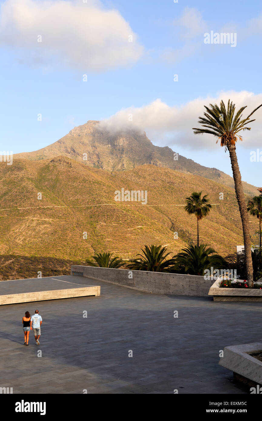 Couple walking across open space of architectural monument 'Plaza of Spain' in Adeje, Tenerife - Stock Image