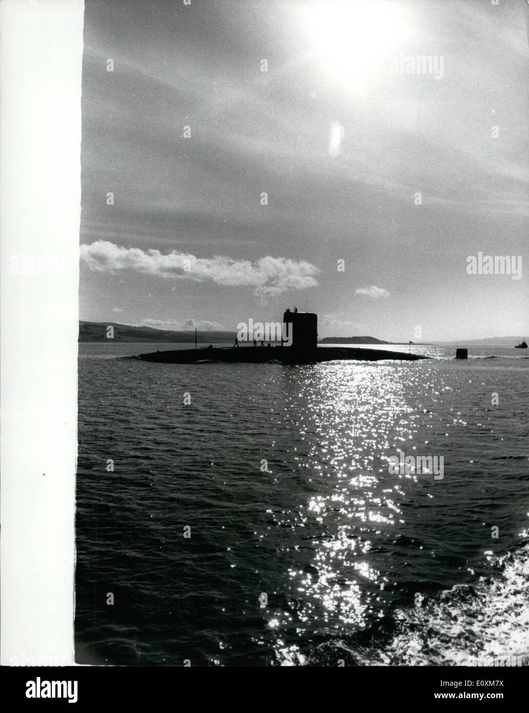 Apr. 04, 1967 - Underwater from Singapore. The nuclear-powered submarine Valiant, 3,500-tons, arrived yesterday at Faslane, Gare Loch, Dunbartonshire, yesterday, at the lend of a 12,000-miles underwater voyage from Singapore - a British record. Photo Shows The nuclear- powered submarine H.M.S. Valiant, pictured yesterday on her arrival at Faslane, Gare Loch, Dunbartenshire. - Stock Image