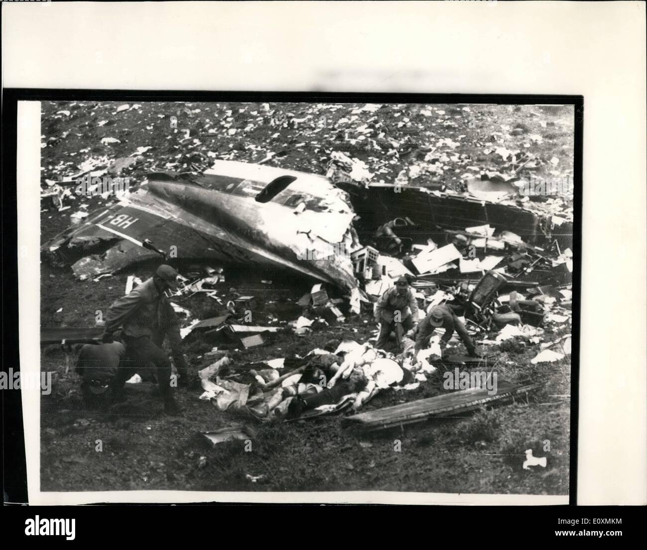 Apr. 04, 1967 - 123 die in airliner crash in Cyprus: A Britannia airliner, hit by lightning, plunged into a hill near Nicosia, Cyprus today, killing 123 people. Globe Air, Swiss owners of the Britannia said that all 118 passengers and five crew members had been killed. Four persons, including an air hostess survived. Photo shows the scene as Cyprus National guard remove victims from the wreckage of the plane after the crash. - Stock Image