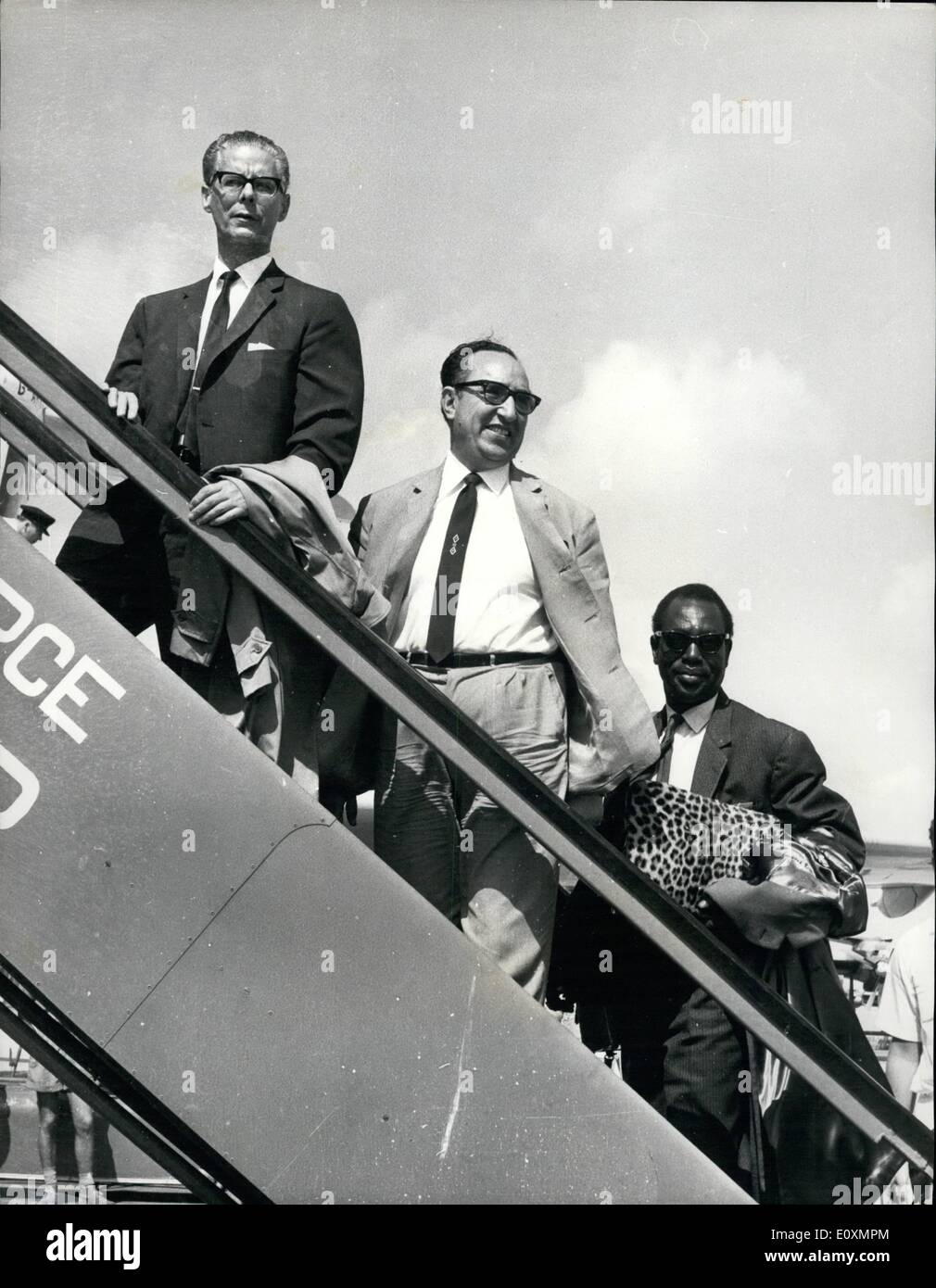 Apr. 04, 1967 - The U.N. Fact-finding mission leave Aden After Accusing Britain of Lac of Co-operation: The United Nations fact-finding mission abruptly left Aden after alleging lack of co-operation by Britain. The three-man mission left by air but there was some considerable delay when the U.N. men objected to going through the routine of having their luggage searohed. Photo shows Three-men U.N. Mission Guerrero, Moussa Leo Keita and Abdul Sttar Shalizi, board the airfcraft for their flight to Rome. - Stock Image