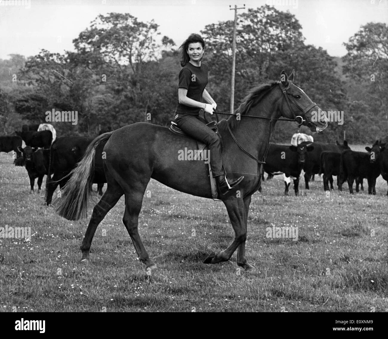 Jacqueline Kennedy horseback riding in the country - Stock Image