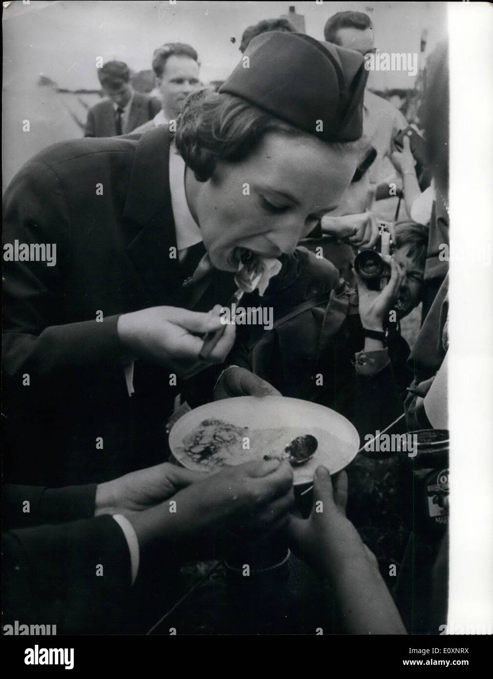 Jul. 07, 1967 - Princess Benedikte visits guide camp: Princess Benedikte of Denmark made a visit to the guide camp near Ringsted in Denmark, were 15,000 girl guides from 21 nations. Photo shows Princess Benedikte is seen tasting a pancake made by one of the guides during her tour of the camp. - Stock Image