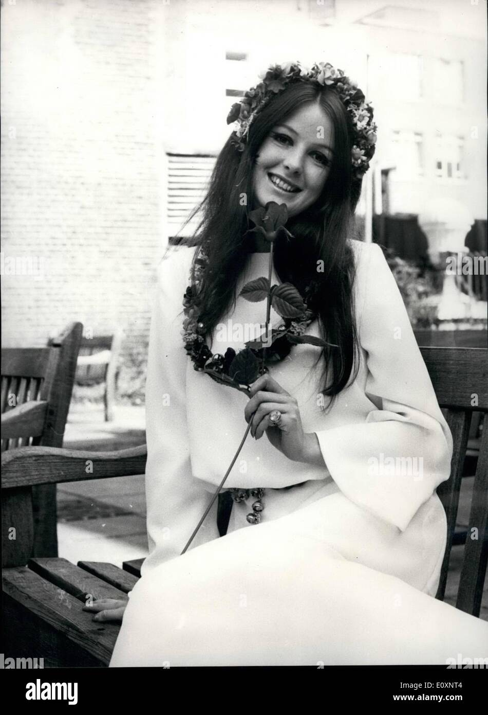 Jul. 07, 1967 - THE HIPPY CULT IN BRIDAL WEAR. The Hippy Cult is now happening in bridal wear and at Young's Dress Hire in Wardour Street, a barefest 'bride' wearing flowers in her hair and balls round her for brides of Aurumn '67. Mr. Louis Young where idesit is to bring out this range, belived teh Hippies, a powerful effect on fashion genertally - Stock Image