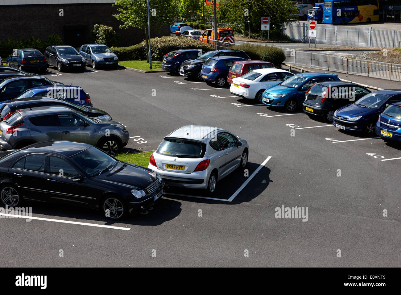 numbered private car park parking bays in Preston England UK - Stock Image