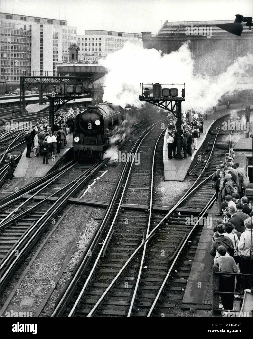 Jul. 07, 1967 - A Waterloo farewell to the era of steam; A merchant Navy class locomotive No. 35008 Orient Line left Waterloo station for Waymouth yesterday with one of two ''Farewell to Steam'' special trains to mark the end of steam on Southern Region main line passenger services. From Monday next, Waterloo Bournmouth Waymouth services will be operated by electric and diesel traction. Photo Shows The scene at Waterloo yesterday as the locomotive made its ''Farewell to Stem'' trip to Waymouth. - Stock Image