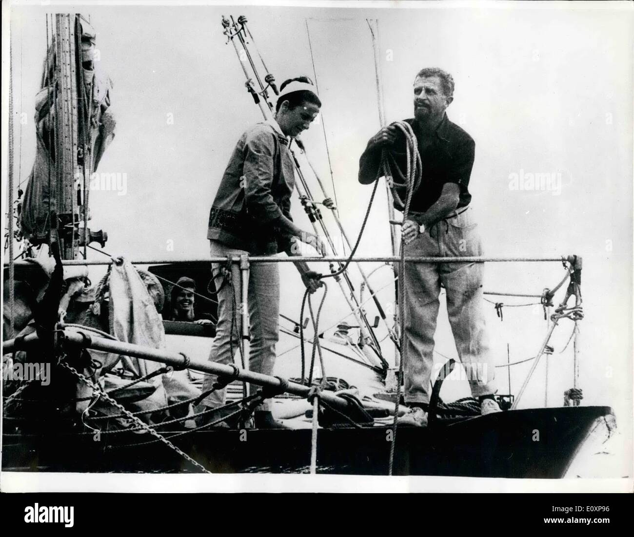 Jul. 07, 1967 - Round the world catamaran arrives home: Dr. David Lewis, 48, and his wife, Fiona, arrived at Plymouth the yesterday at the end of his three year around the world voyage of 38,000 miles, in the 42ft. catamaran, Reuben moans. on board with them wears their children susin, 5, and Vicky 4, and Miss Priscilla cairns, 34 . who acted as navigater from Tahiti, Mrs. Lewis and the children joined the best in New York on her outward journey. Photo Shows Mrs. Fiona Lewis and Dr. David Lewis, 'make fast' the cameraman ''Rehu Moana'' in Plymouth Sound yesterday - Stock Image