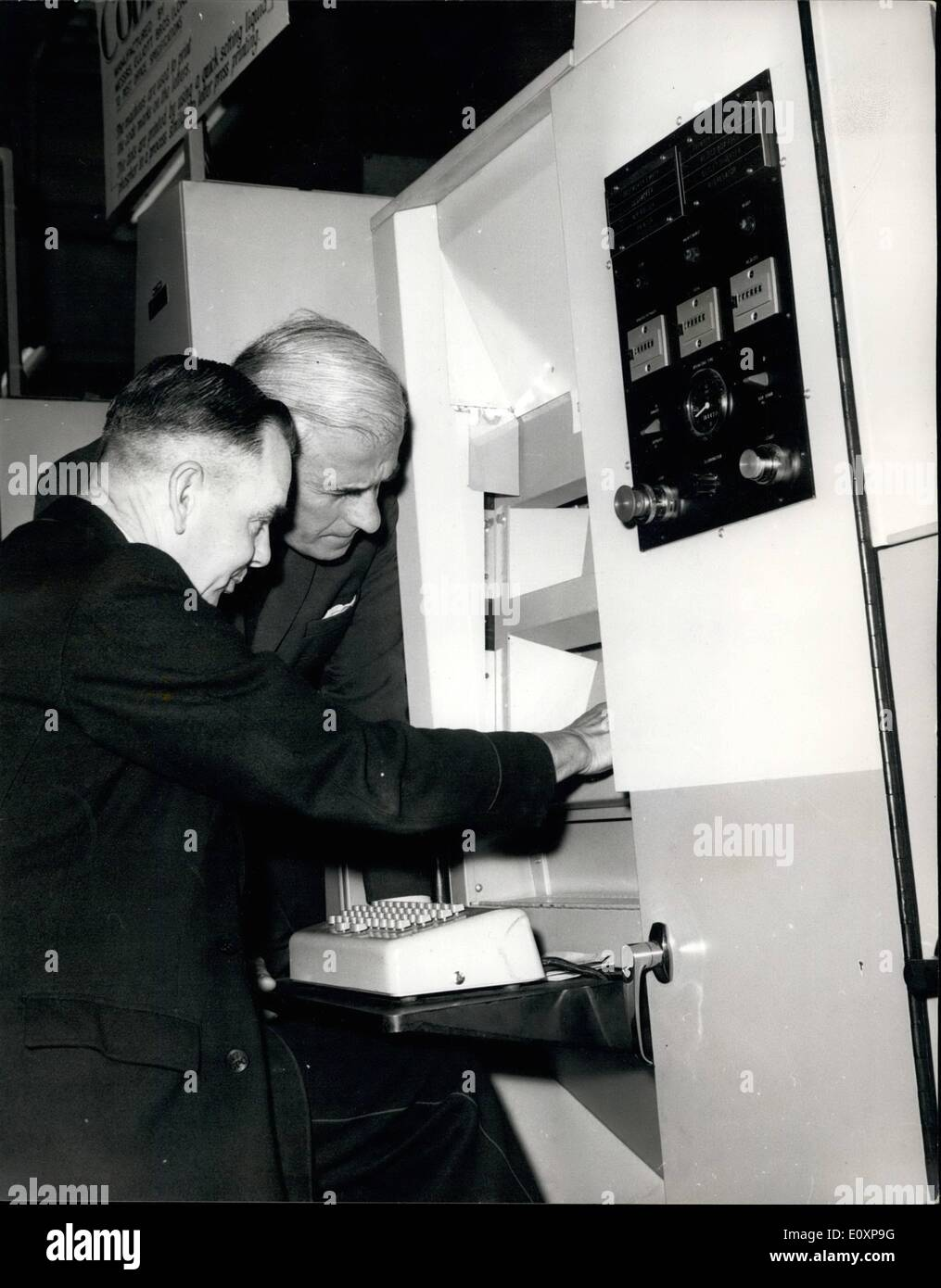 Jul. 07, 1967 - Postmaster general opens postal Fortnight, 1967. Following the success of the Postal week held in a 1963, a postal fortnight on similar lines, was opened today by the Postmaster General, the Rt. Hon. Edward Short, at a Press Conference at Norwich, where there is a prototype fully-mechanised letter sorting office. The train on which members of the Press travelled to Norqich with thw PMG included a Travelling Post Office ach so that the press party were able to see sorting being carried out on the move. Photo shows Mr. Edward Short, the PMG, chats to Mr. G - Stock Image
