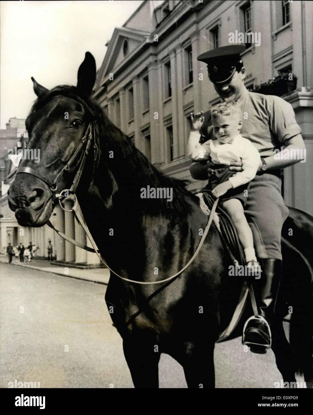 Jul. 24, 1967 - Boy Is Guest Of The Household Cavalry: Four-year-old David Rayne, who was injured in an accident at the close of the Trooping the Colour ceremony inviting a horse belonging to the Foot Guards, on 10th. June, was today the VIP guest of honour of the Household Cavalry Regiment, with whom the horse was in no way connected - at Wellington Barracks, because they decided it would be a good idea to introduce him to the horses so that he would not be afraid of them - Stock Image