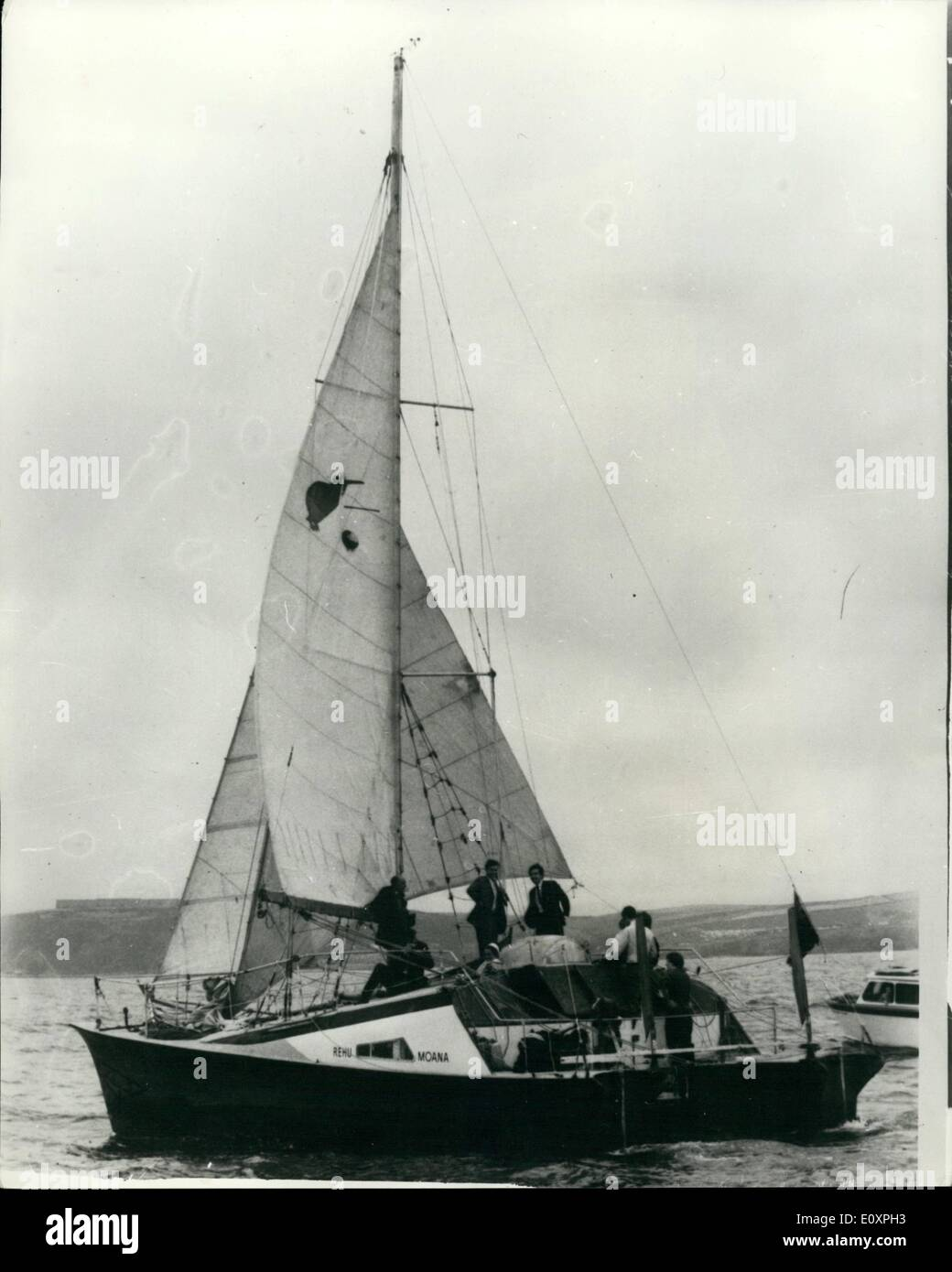 Jul. 28, 1967 - 28-7-67 Round the world Catamaran arrives home. Dr. David Lewis, 48, and his wife, Fiona, arrived at Plymouth yesterday at the end of his three-year old round the world voyage of 38,000 miles, in the 42 ft. catamaran, Rehu Moana. On board with them were their children, Susie, 5 and Vicky, 4, and Miss Priscilla Cairns, 34, who acted as navigator from Tahiti. Mrs. Lewis and the children joined the boat in New York on her outward journey. Photo Shows: The catamaran Rehu Moana enters Plymouth Sound at the end of the voyage yesterday. - Stock Image
