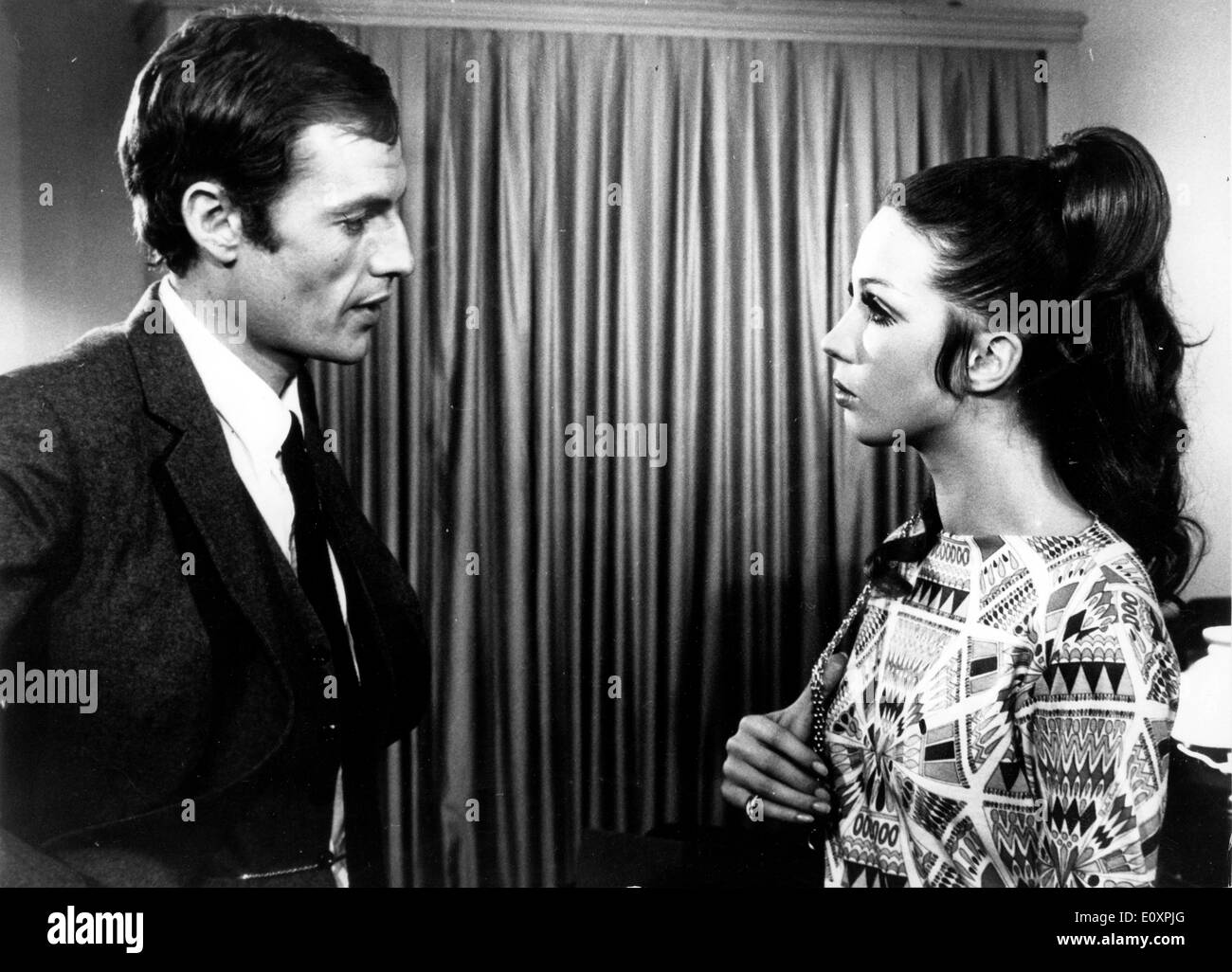 Actors Lilly Bistrattin and Claude Mann talking - Stock Image