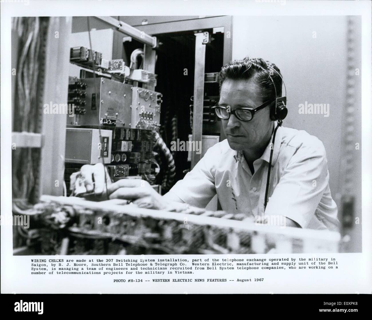 08, 1967 - wiring checks are made at the 307 switching system installation