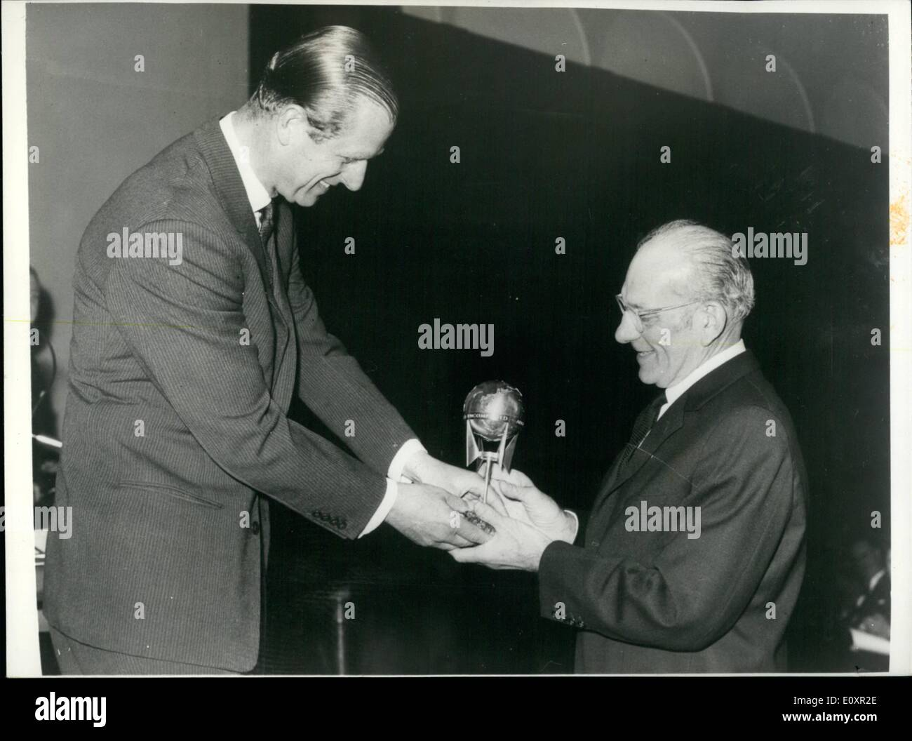 Oct. 10, 1967 - PRINCE PHILLIP PRESENTS AWARDS TO SIR FRANCIS CHICHESTER. PRINCE PHILLIP yesterday presented three awards to SIR FRANCIS CHICHESTER, at the institute of Navigation annual meeting, at the Royal Geographical Society, Kensington Gors, London. The awards were (1) A special award made by the Institute of Navigation to Sir Francis for his circumnavigation of the globe.(2) The superior Achievment Award of the American Institute of Navigation and (3) the Gold Medal of the Australian Institute of Navigation - Stock Image
