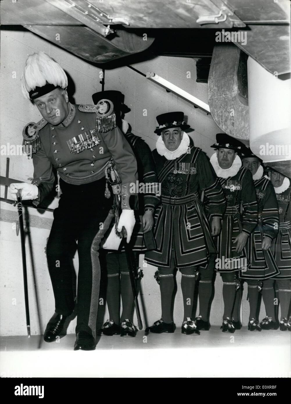 Oct. 10, 1967 - State Opening of Parliament Searching the Vaults.: Colonel J.D. Hornung, officer in charge of the Queen's Bodyguard, ducks under the central heating duets as he leads men of the Queen's Bodyguard in their traditional search of the vaults of the houses of Parliament today, before the State opening Houses of Parliament today. before the state opening ceremony by H.M. Queen Elizabet II. The search is made to ensure no attempt is being made to blow up Parliament while the Queen is present, - Stock Image