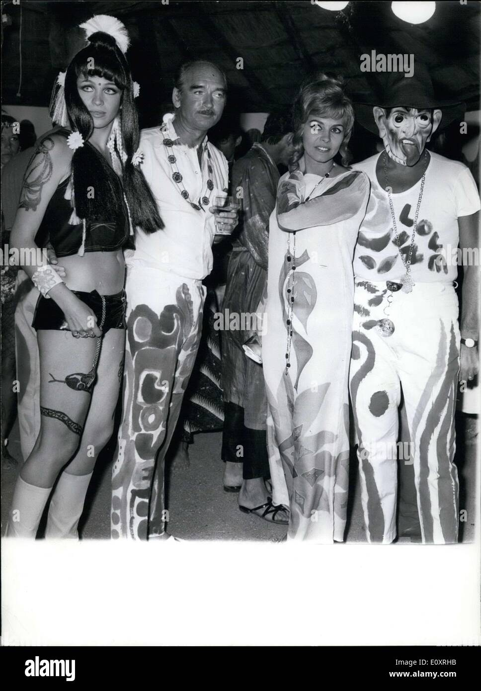 Aug. 14, 1967 - Until today, France was spared from psychedelic fashion-- by that we mean, a crazy fad started across the Atlantic. Thanks to Eddie Barclay, CEO of a big disco company, psychedelic fashion just appeared in St. Tropez, which truly doesn't suit it at all. (From left to right) Marie-Christine Barclay, wife of Eddie Barclay; Eddie Barclay; Michele Mercier and guest. - Stock Image